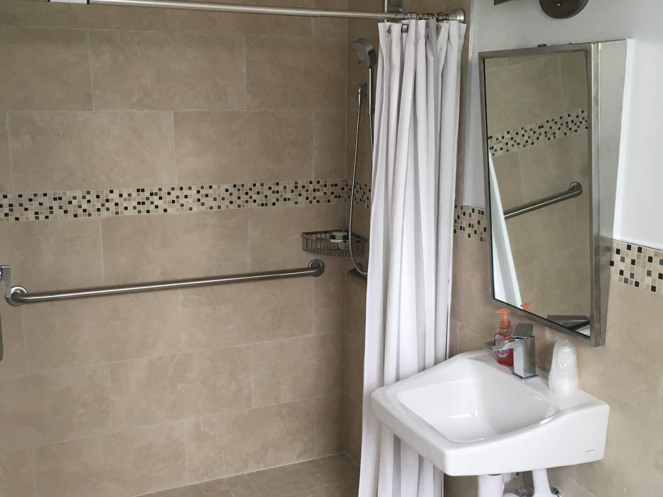Shower with sink and mirror on the right