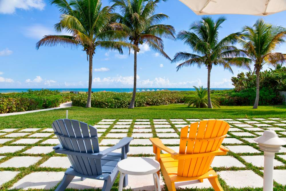 Blue and orange chairs outside with beach in the background