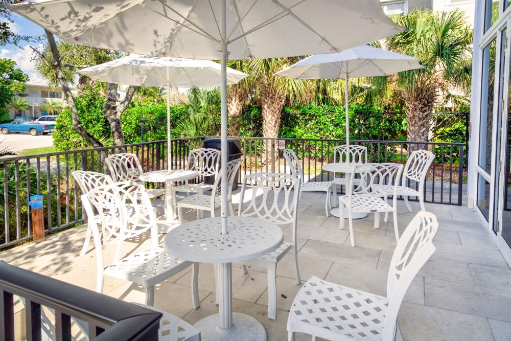 Patio with umbrellas and chairs