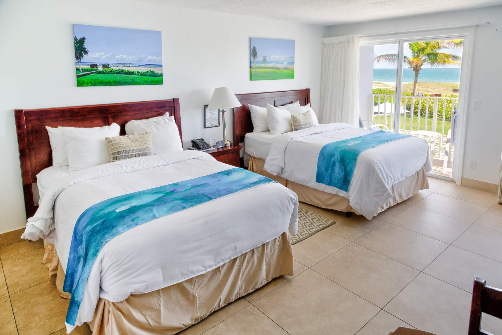 Two bed with outdoor beach view