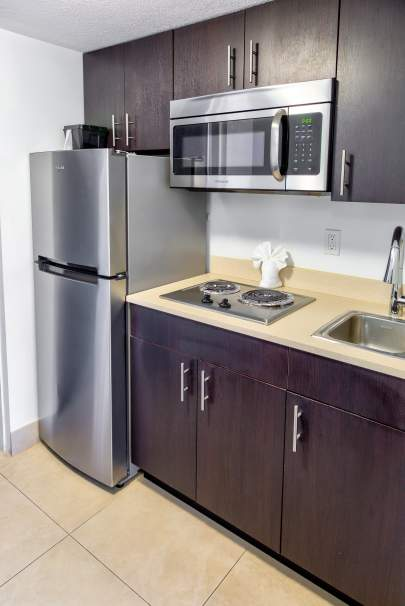 Kitchen with fridge and microwave